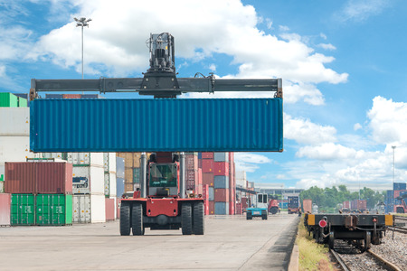 container box: forklift handling container box loading to freight train