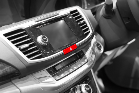 control panel lights: Emergency lights button in modern car