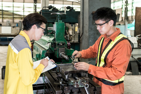 mechanical men: Asian Mechanical Engineer checking equipment in factory Stock Photo