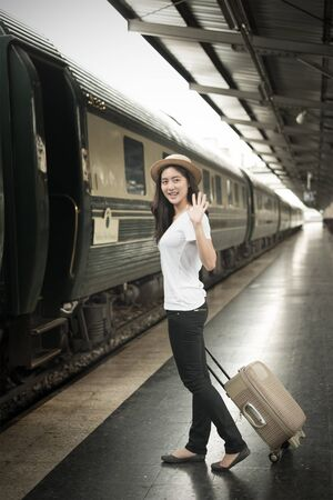 pulling beautiful: Shot of a beautiful young Asian woman traveling pulling a luggage