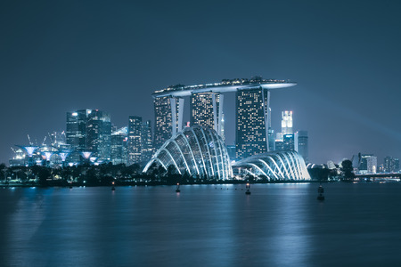 commercial district: Singapore skyscaper in marina bay at night