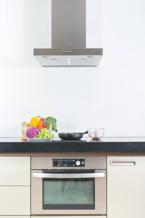 oven range: Modern gourmet kitchen interior with vegetable ,egg and pan