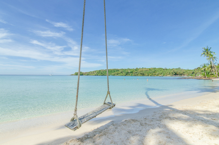 Summer, Travel, Vacation and Holiday concept - Swing hang from coconut palm tree over beach sea in Phuket ,Thailand.
