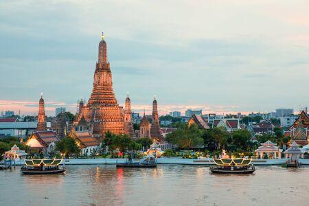 thai temple: Wat Arun and cruise ship in night ,Bangkok city ,Thailand