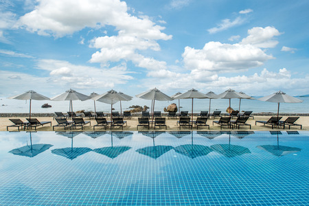 resort: Summer, Travel, Vacation and Holiday concept - Tropical beach resort with lounge chairs and umbrellas in Phuket ,Thailand