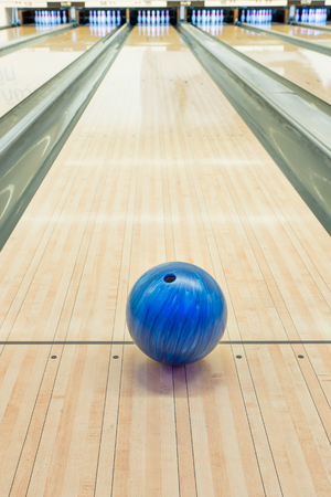 bowling strike: Balls on bowling alley against ten pins
