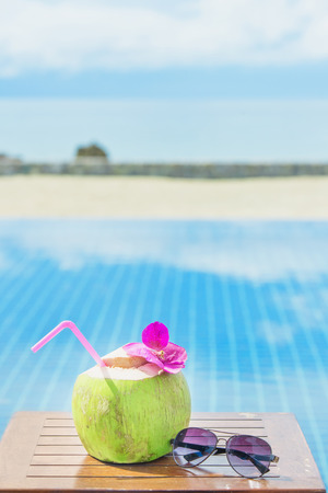 thailand beach: Summer, Travel, Vacation and Holiday concept - Tropical fresh coconut cocktail with pool and beach in ocean, Phuket ,Thailand