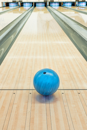 alley: Balls on bowling alley against ten pins