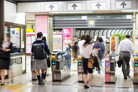 Blurred abstract background of many people on subway train, japan subway