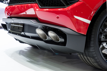 car engine: Car interior : Closeup of red sport car with dual exhaust pipe