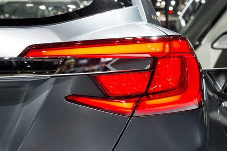 tail light: Detail on the rear light of a car.