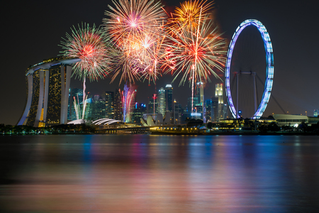 fire works: Fireworks over Marina bay in Singapore on New years fireworks celebration Editorial