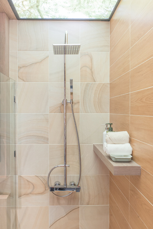 bathroom: Modern shower head in bathroom Stock Photo