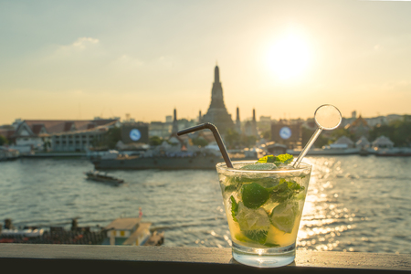 thailand bangkok: Mojito cocktail on table in rooftop bar with famous place background. Wat Arun ,Bangkok ,Thailand