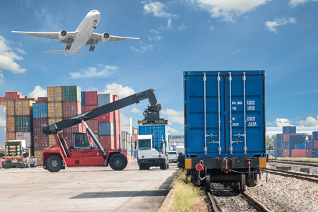 railway transports: forklift handling container box loading to freight train