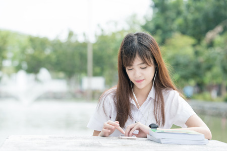thai student: Asian student with uniform using smartphone