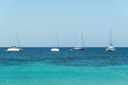 windy day: Yacht sailing on tropical sea at windy day Stock Photo