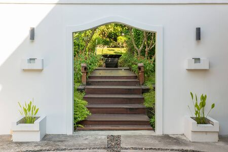 wicket door: Decorative arched gateway to a garden Stock Photo