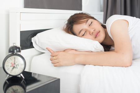 Asian beautiful girl sleeps in the bedroom