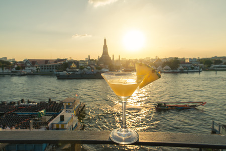 bangkok: Pineapple cocktail on table in rooftop bar with famous place background. Wat Arun ,Bangkok ,Thailand