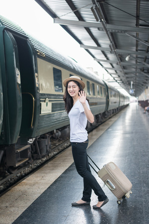 goodbye: Young Asian woman say goodbye to boyfriend at train station before journey