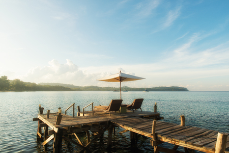 rest and relaxation: Summer, Travel, Vacation and Holiday concept - Tropical beach resort with lounge chairs and umbrellas in Phuket ,Thailand
