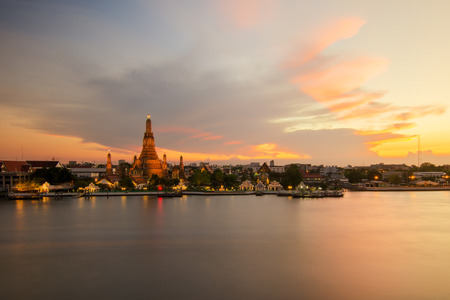 Night view of Wat Arun temple and Chao Phraya River, Bangkok, Thailand