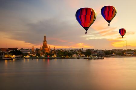 phraya: Colorful hot-air balloons flying over Wat Arun temple and Chao Phraya River, Bangkok, Thailand