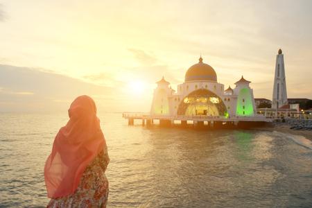 islamic wonderful: Malacca Straits Mosque with Muslim pray in Malaysia Stock Photo