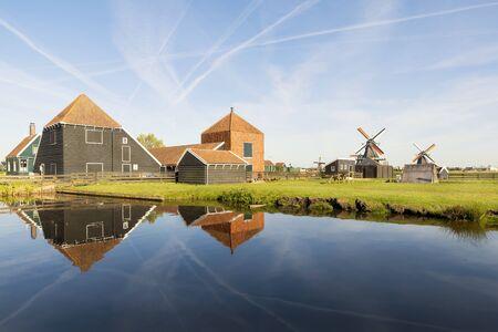 destination scenics: Traditional Dutch windmills with canal in Zaanse Schans at Amsterdam, Netherland