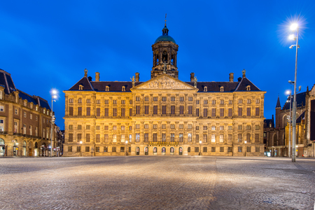 dutch landmark: Royal Palace in Amsterdam on the Dam Square in the evening. Netherlands