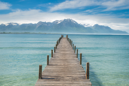 Summer, Travel, Vacation and Holiday concept - Wooden pier in lake at Switzerland