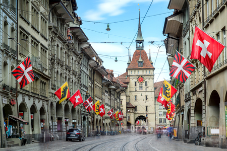 Shopping alley with the famous clocktower of Bern in Switzerland