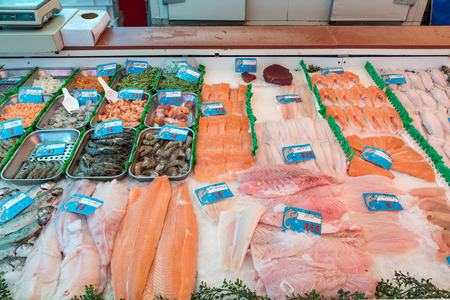fish shop: Seafood on ice at the fish market in Amterdam, Netherland. Many fish and seafood in shop at market. Fresh seafood and fish in Europe.