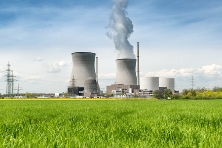 Nuclear power Energy concept - Nuclear power plant with green field and big blue clouds. Nuclear power plant in Germany 에디토리얼