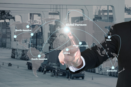 forwarding agency: Businessman working with virtual interface global partners graphic use for logistic,import,export background.Global partners network.