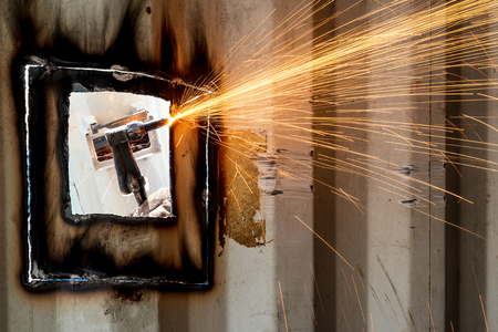 Industry worker with welding steel to repair container structures manufacture workshop in factory industry. Stock Photo