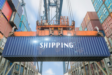 Loading containers box from cargo freight ship with big crane use for import,export,Logistics background.