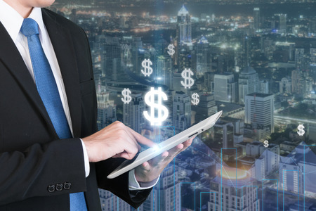 e money: Business technology concept - Double exposure of business man using the tablet for e business earning money Stock Photo