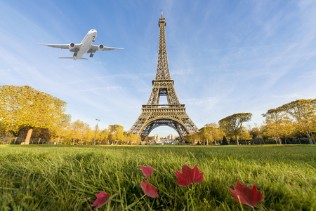 Airplane flying over Eiffel Tower, Paris, France. Eiffel Tower is international landmark in Paris, France Imagens