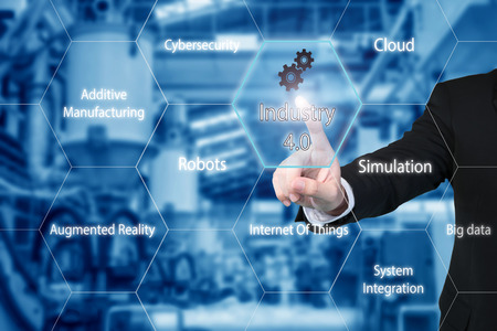 Business man touching industry 4.0 icon in virtual interface screen showing data of smart factory. Business industry 4.0 concept.