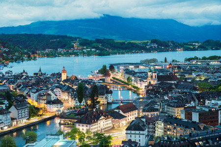 water town: Aerial view of old town of Lucerne, wooden Chapel bridge, stone Water tower, Reuss river and Lake Lucerne, Switzerland