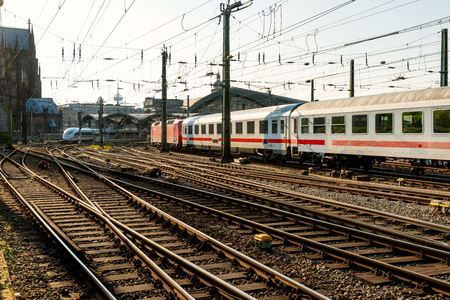 railway transportation: Railway train tracks at a Europe major train station at sunset. Railway transportation concept.