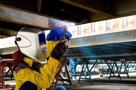 Industrial workers: Worker repair the damage bottom side of container , Industrial , factory welding closeup