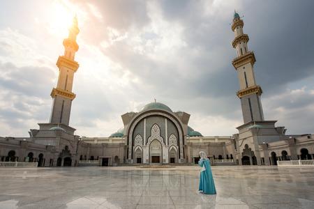 islamic wonderful: Wilayah persekutuan mosque with Islamic Malaysian muslim pray at mosque in Kuala Lumpur, Malaysia Stock Photo