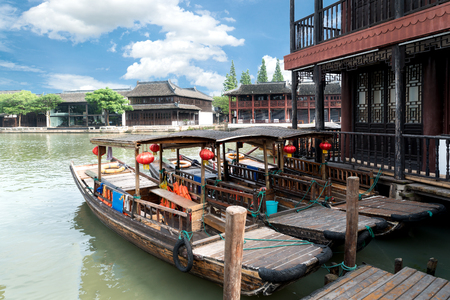 water town: China traditional tourist boats on canals of Shanghai Zhujiajiao Water Town in Shanghai, China Editorial