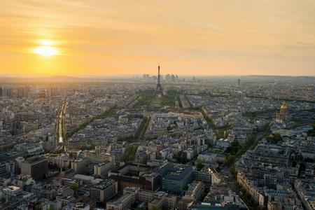 international landmark: Aerial view of Paris with Eiffel tower at sunset in Paris, France. Eiffel tower is international landmark in Paris, France.