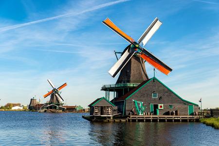 dutch: Traditional Dutch old wooden windmill in Zaanse Schans, Netherlands. Museum village in Zaandam, Netherlands.