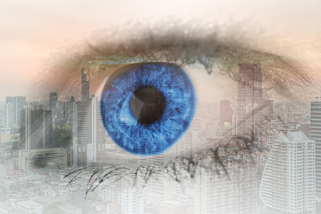 multiple: Double exposure image of human eye with business center district Bangkok city. Business future concept.