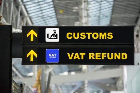 Airport Tax refund and customs sign in terminal at airport Foto de archivo